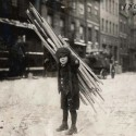 Young boy carries scrap wood, n.d. Gelatin silver print. Courtesy of the Community Service Society Records, Collection of the Rare Book & Manuscript Library, Columbia University.