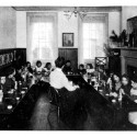 Kindergarten class at the College Settlement. From The Leaven in a Great City by Lillian William Betts