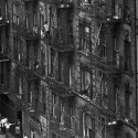 Tenement houses on E. 100th Street in East Harlem. Puerto Rican migrants entered the neighborhood in large numbers. By the 1960s they were the predominant ethnic group in the area. Bruce Davidson, Magnum Photos.