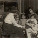 Friendly visitor with family, c. 1900. Courtesy of the Community Service Society, Collection of the Rare Book & Manuscript Library, Columbia University.