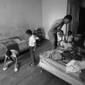 8/21/1983 - Rosalie Jenkins and her children cleaning up their room in the Granada Hotel, on Ashland Place in the Fort Greene section of Brooklyn. Marilyn K. Yee/The New York Times