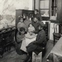 Family in tenement living room c. 1890. Courtesy of the Community Service Society Records, Columbia University Rare Book & Manuscript Library.